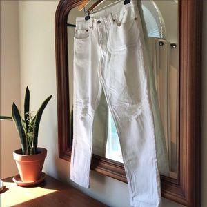 Distressed white LEVI jeans